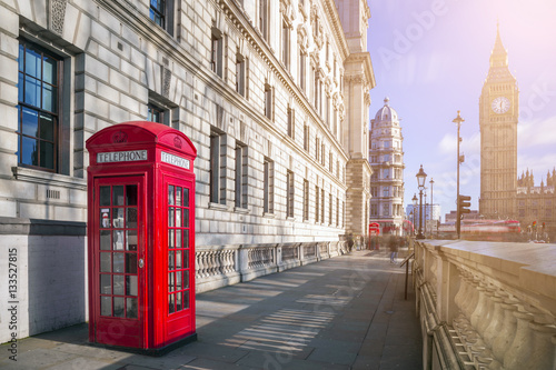 Foto op Canvas Londen rode bus London, England - Traditional red British telephone box with Big Ben and Double Decker bus at the background on a sunny afternoon