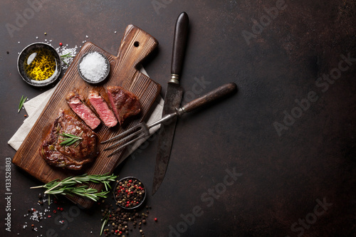 Staande foto Vlees Grilled ribeye beef steak, herbs and spices