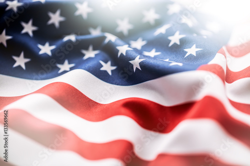 USA flag. American flag. American flag blowing wind. Close-up. Studio shot.