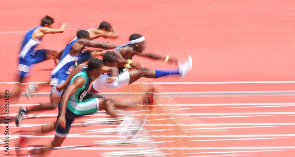 Fototapety, obrazy: Jumping over hurdles, motion blur