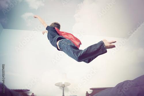 Super hero flying into imagination Poster