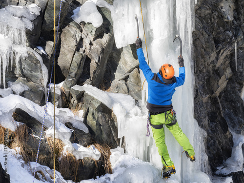 man climbing ice in mountain