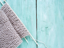 Knitted Scarf On Turquoise Woo...