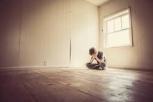 Sad Boy Alone In A Bare Room