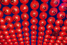Chinese Red Lanterns Hanging In Street At Night For Decoration During The Chinese New Year Festival At Chinatown, Thailand.Chinese Red Lanterns Illuminated At Night