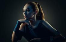Low Key Portrait Of A Beautiful Girl. Studio Shot