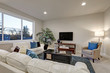 White and beige living room interior with blue accent rug