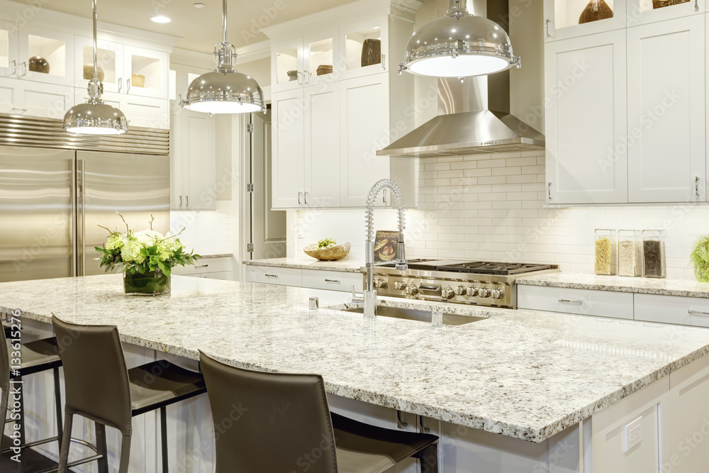 Fototapeta White kitchen design in new luxurious home