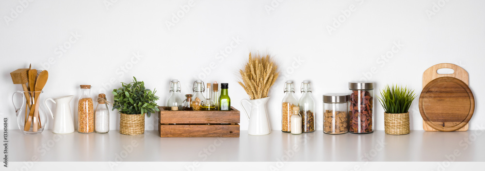 Obraz Kitchen shelf with various herbs, spices, utensils on white background fototapeta, plakat