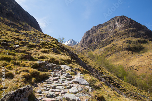 Photo  Path up to Glencoe snow topped mountains Scotland UK in Scottish Highlands in sp