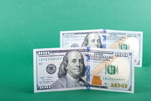 Two Hundred Dollars Banknotes On The Isolated Background