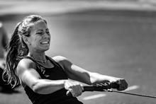 Woman On Rowing Machine On Com...