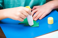 Child Making Christmas Card