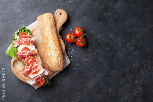 Staande foto Snack Sandwich with salad, prosciutto and mozzarella