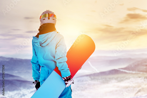 obraz dibond Snowboarder woman girl sunrise mountain top