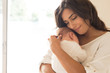 Leinwanddruck Bild - Woman with newborn baby