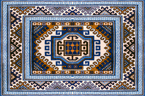 Obraz na plátně  Motley woolen carpet with ethnic folk geometric pattern in blue and brown shades
