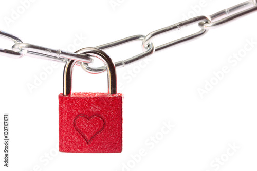 Photographie  Red heart shape over rustic padlock on isolated