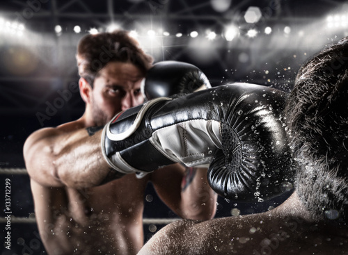 Boxer in a boxe competition beats his opponent Canvas Print