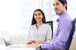 Happy Male and Female Coworkers Working in Office