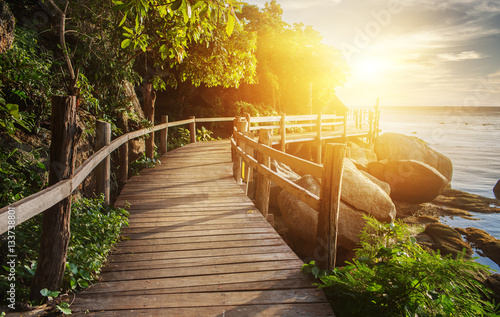 Tuinposter Bruggen Thailand sunset view from wooden bridge on koh Phangan island