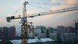workers at a construction site collect construction crane at sunset, 4k