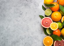 Citrus Fruit On Grey Concrete Table. Food Background. Healthy Eating