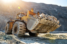 Wheel Loader Machine Unloading Rocks