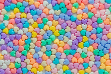 Colorful Pastel Of Heart Shaped Beads On White Background, Use A