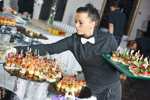 Fotografie, Obraz  Waitress serving catering table