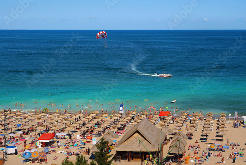 Poster Egypte Resort Sunny Beach Bulgaria panorama of the beach in summer. Panoramic top view Sunny Beach Bulgaria. The boat and a parachute into the sea.