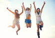 canvas print picture Three agile energetic teenagers leaping in the air