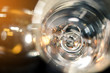 Selective focus of wedding diamond rings in champagne cup with sun light