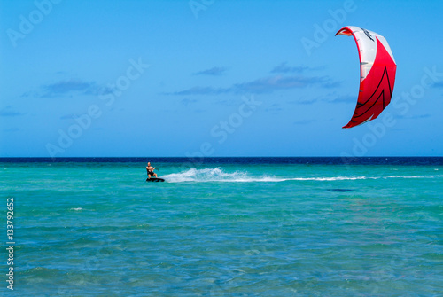 Man practicing kitesurf on Mayotte island, France