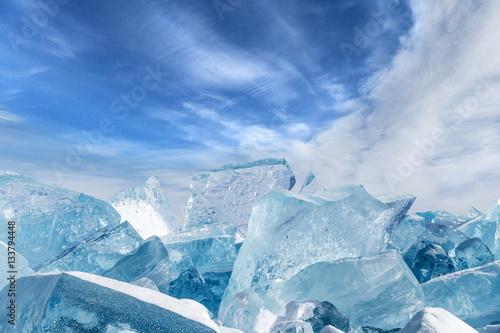 Foto op Plexiglas Arctica Blocks of broken blue ice on sky background