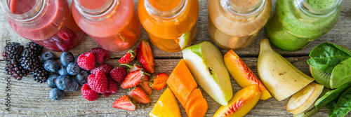 Foto auf Leinwand Saft Selection of colorful smoothies on rustic wood background