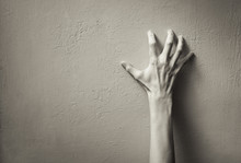 Hand Clawing Up A Wall. Frustration, And Anger Concept.