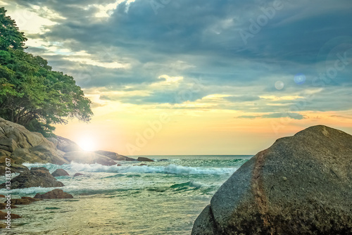 Foto op Canvas Zwavel geel Landscape with rocks and rough sea at sunset