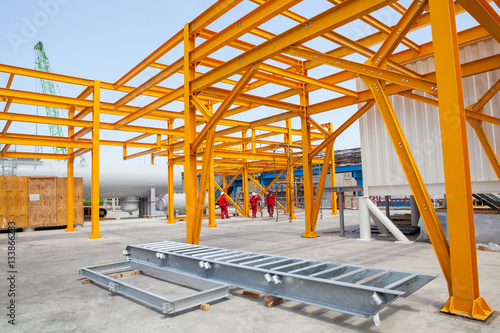 Fotomural Yellow steel construction in open at factory.