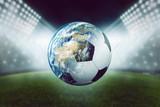 Fototapeta Sport - Fussball mit Welt vor Stadion