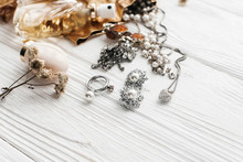 Luxury Expensive Jewelry Rings Earrings And Perfume On White Rus