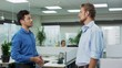 Two young confident businessmen discussing ideas at office. Shaking hands Slow motion