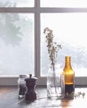 Condiments And Vase On Windowsill