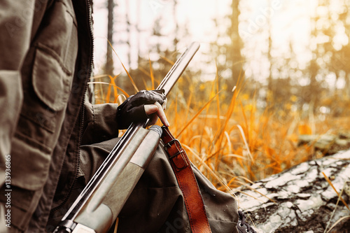 Aluminium Prints Hunting Autumn hunting season. Woman hunter with a gun.