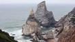 Atlantic ocean coast (granite boulders and sea cliffs) in misty weather. View from Cape Roca (Cabo da Roca), Portugal.