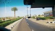 Road in Egypt. View from Sightseeing Bus goes on the Road near the Sun Palms and Hotels