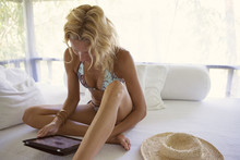Sensuous Woman Using Tablet Computer In Gazebo