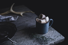 Cup Of Hot Chocolate Topped With Marshmallow On Wooden Table