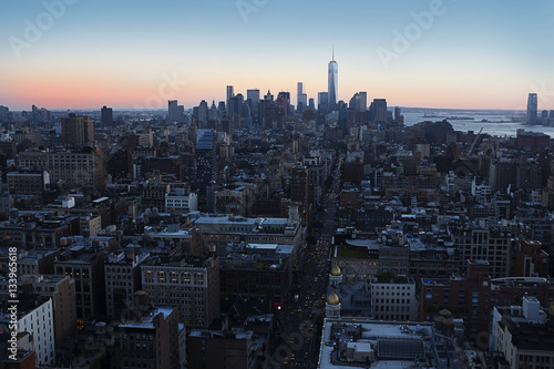 One World Trade Center amidst cityscape during sunset плакат