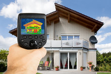 Person Using Infrared Thermal Camera Outside The House